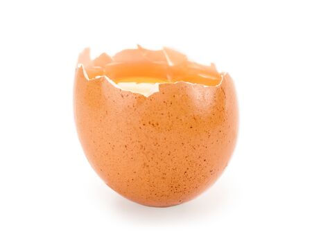 Broken brown egg isolated on white with clipping path. Selective focus on the yolk