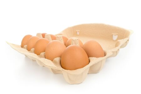 Pack of large brown hen eggs with cardboard box wide angle view isolated on white Stock Photo