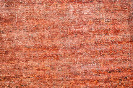 Large red rough brick wall. Texture and background