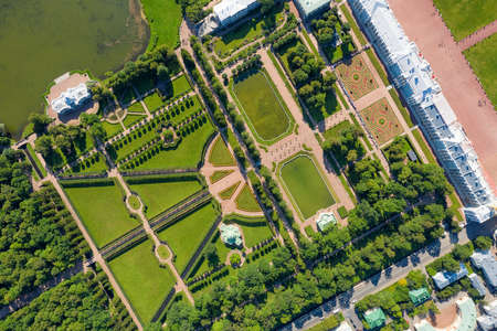 PUSHKIN, SAINT PETERSBURG. RUSSIA - JULY 26 2019. The Catherine Palace and garden top aerial view at sunny day.