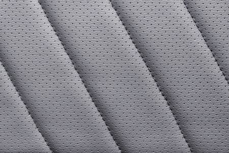 Gray diagonal stroked artificial leather close up. Large macro texture and background