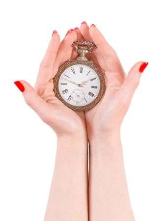 Woman hands holding ancient watch. Isolated on white