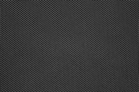 Carbon black fiber close up. Texture and background