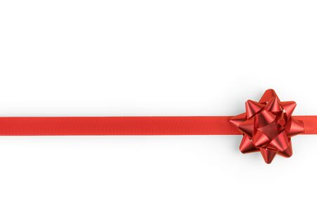 Red decorative bow and ribbon isolated on white with copy space. Clipping path included