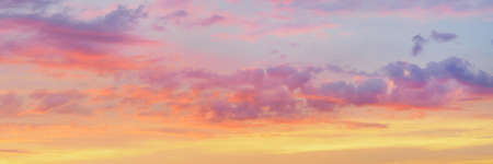 Dramatic bright colored clouds at sunset. Natural texture and background
