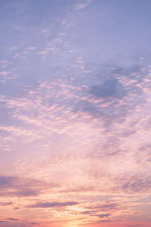 Dramatic cloudy pastel colored sunset sky. Natural background
