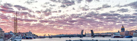 Neva river in Saint Petersburg ultra large panoramic view with divorced bridge, Hermitage, st. Isaak cathedral and Admiralty at white nights. Stok Fotoğraf