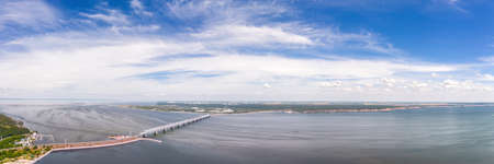 Large aerial panoramic landscape of Volga river in Ulyanovsk, Russia with old Imperial bridge. At cloudy day