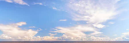 Large panoramic cloudscape over sea. Dramatic landscape at bright sunny day. Stok Fotoğraf