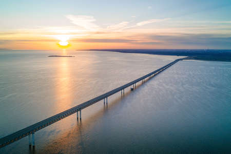 Sunrise over Volga river and long President bridge in Ulyanovsk, Russia. Aerial view