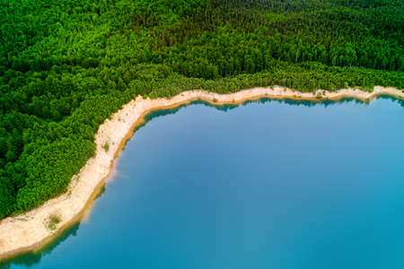 Idyllic turquoise colored lake in the forest. Panoramic aerial landscape