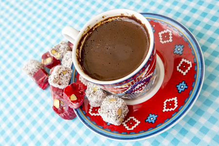 the brewer: A cup of Turkish traditional coffee, Turkish sweets