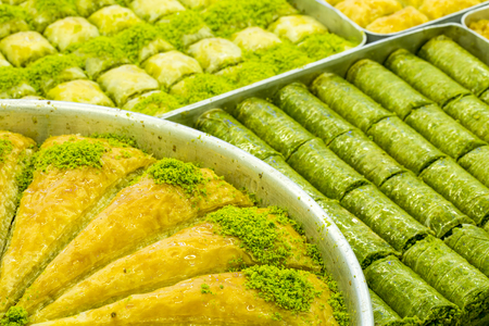 Baklava with pistachio Turkish pastry dessert on a authentic cooper tray 版權商用圖片