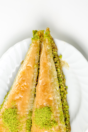 Baklava with pistachio Turkish pastry dessert on a authentic cooper tray Stock Photo