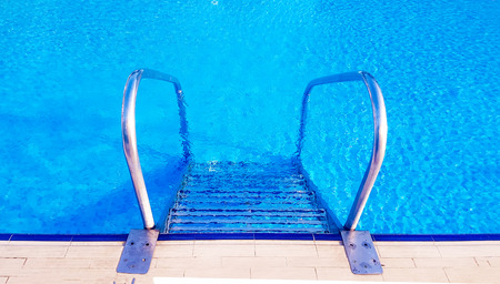 The pool stair detail, blue swimming pool