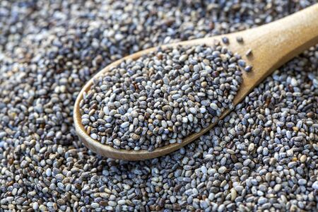 Top view of chia seeds. Can be used as background. The people of the ancient Aztec and Incan empires revered chia seeds as viral nourishment.