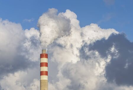 Factory chimney smoke with blue sky and clouds