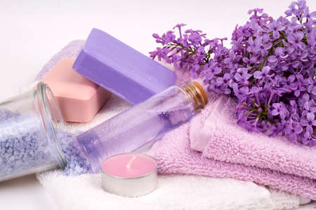 Lilac nature cosmetics, handmade preparation of essential oils, perfume, creams, soaps from fresh and lilac flowers Stok Fotoğraf