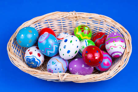 Easter eggs on the blue background. Colorful eggs.