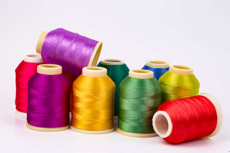 Colored thread coils on white background, sewing, place for text 스톡 콘텐츠