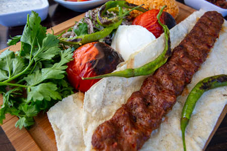 Traditional delicious Turkish foods; Adana kebab. Food concept photo.