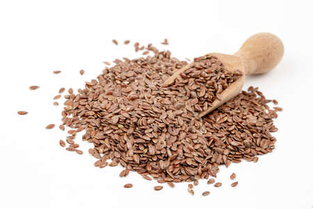 Linum usitatissimum is scientific name of Brown Flax seed. Also known as Linseed, Flaxseed and Common Flax. Pile of grains, isolated white background.