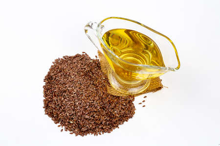 Flax seeds and oil isolated on white background