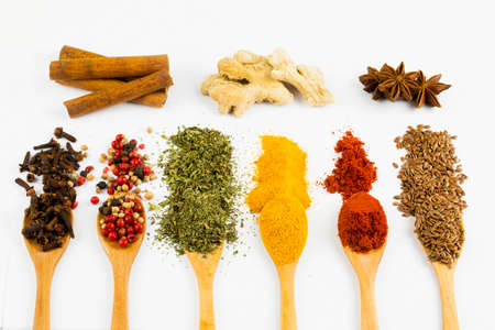 Mixed various spices on the white background Imagens