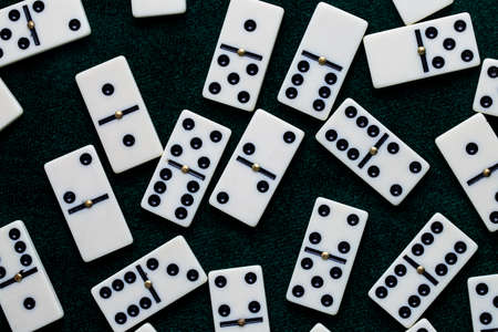 Falling dominoes. Domino effect. The domino game. Stock Photo
