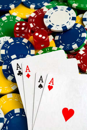 Ace playing cards with red dice. Casino betting and gambling concept and poker chips. 写真素材 - 152076996