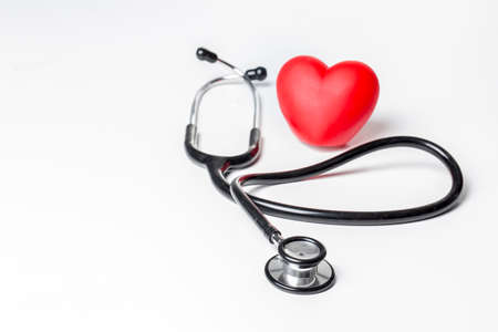 Stethoscope and red heart. Heart Check. Concept healthcare.