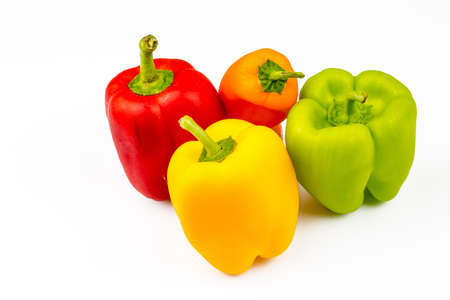 Fresh colorful peppers on the white background