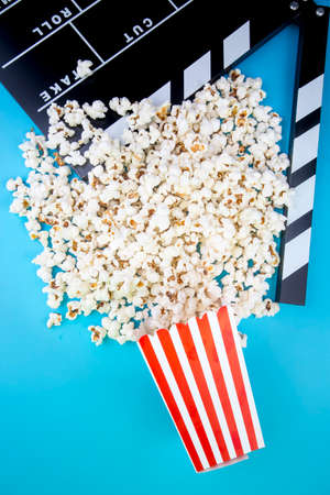 Movie cinema and popcorn concept photo on the blue background