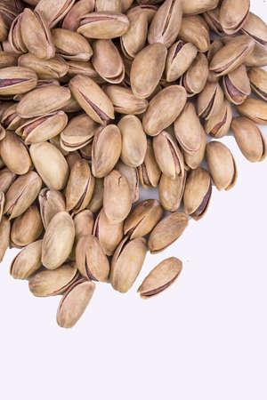 Pistachio texture. Nuts. Green fresh pistachios as texture. Standard-Bild