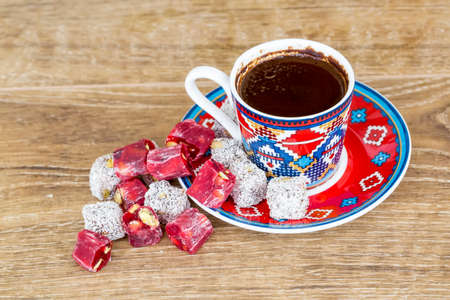 Turkish coffee with delight and traditional copper serving set Stock Photo