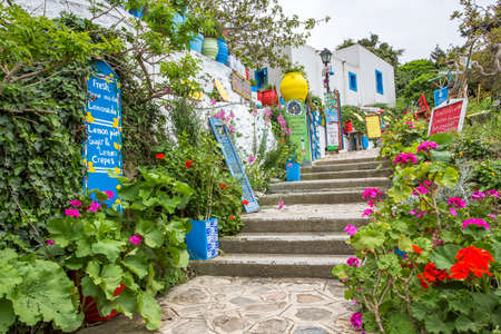 April 15th 2018 - Kos island, Greece - Street with touristic stores and taverns in the traditional Zia village, Kos island Editorial
