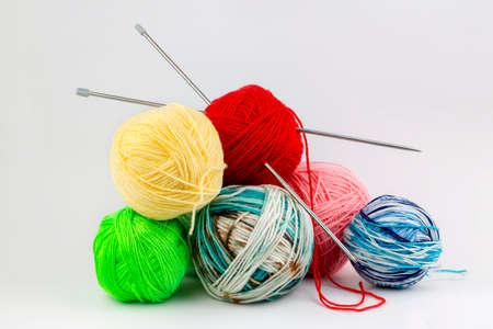 Close up shot of colored wool yarn balls as background Фото со стока