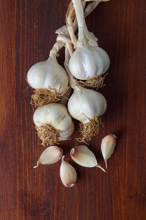 Freshly picked garlic in azure basket on market. Useful vegetables for spicy, spice. Macro photo onion. Top view. Close up.