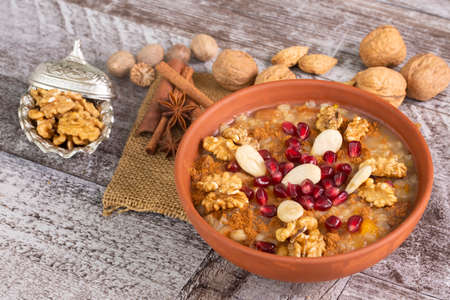 Traditional delicious Turkish desserts; Ashura (Asure). Food concept photo.