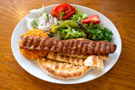 Traditional delicious Turkish foods; grilled meat, Adana kebab Stock Photo