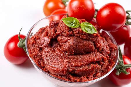 Fresh tomatoes and tomato paste