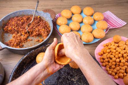 "Traditional Turkish Food; Stuffed Meatballs, Turkish known as ""icli kofte"". Woman making Stuffed Meatballs at home."