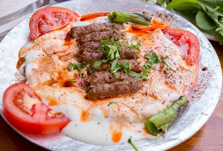 Traditional Delicious Turkish foods collection; Manisa Kebab, grilled meatball with yoghurt