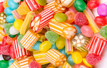 Colorful lollipops and different colored round candy. Top view. Standard-Bild