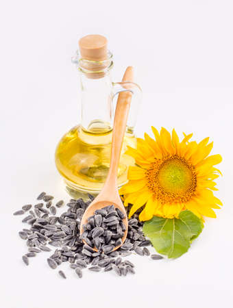 Sunflower, sunflower oil and sunflower seeds, background