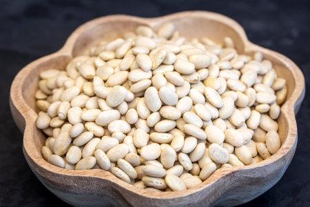 Dry raw beans on the black background 免版税图像