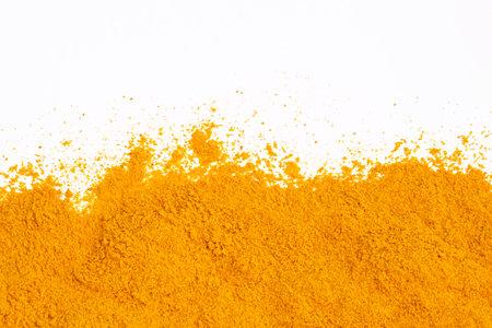 Turmeric powder isolated on white background.