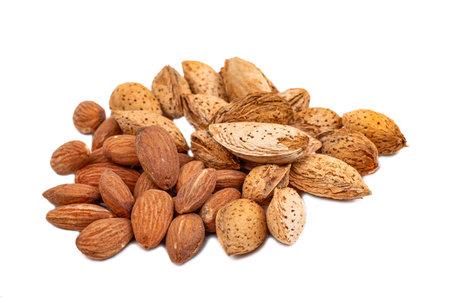Almond oil on the white background. Organic herbal oil. 免版税图像
