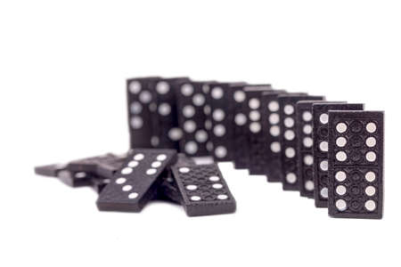 Falling dominoes. Domino effect. The domino game.