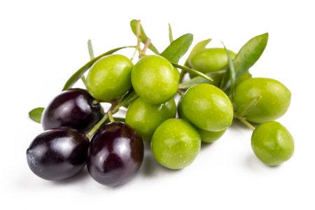 Green fresh olives on the white background
